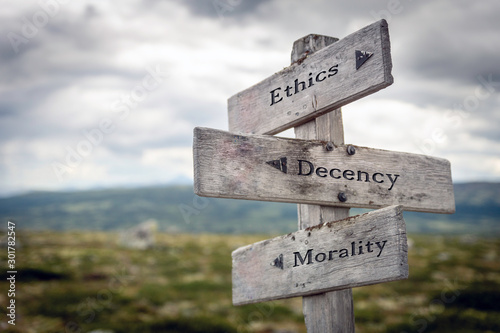 Ethics, decency and morality text on wooden sign post outdoors in landscape scenery. Business, quotes and motivational theme concept.