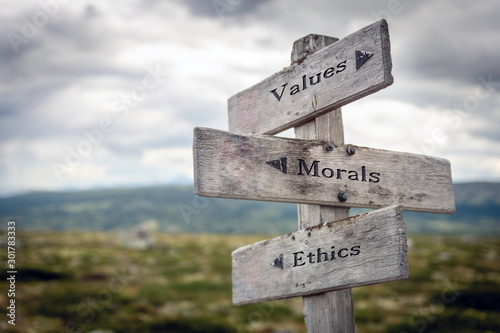 Fotografia  Values, morals and ethics text on wooden sign post outdoors in landscape scenery