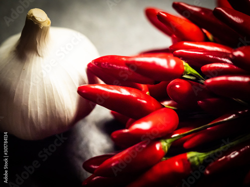 Foto op Aluminium Hot chili peppers Red Peppers And White Garlic