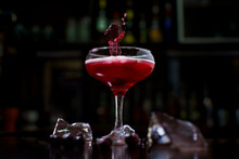 Creative Red Cocktail With Splash And Berries