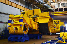 Production Process Of Heavy Mining Trucks At The Factory. Dump Truck On The Industrial Conveyor In The Workshop Of An Automobile Plant. Manufacturer Of Haulage And Earthmoving Equipment, Haul Trucks