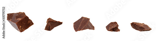 Cuadros en Lienzo  Broken chocolate pieces isolated on white with clipping path
