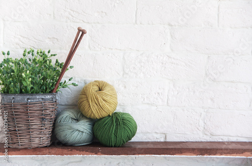 Fotografiet  balls of cotton thread and a shabby old pot on a shelf, artificial flowers, decor elements