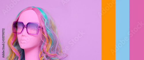 Photo Girl mannequin in a colored wig and glasses.  Unicorn pastel mood
