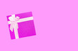 canvas print picture - Red gift box with pink ribbon isolated on pink background.
