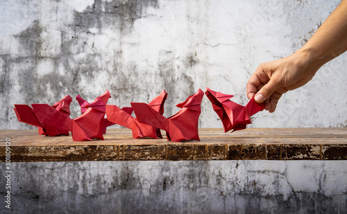 Photo  Origami, from ori meaning folding, and kami meaning paper (kamichanges to gami due to rendaku)) is the art of paper folding