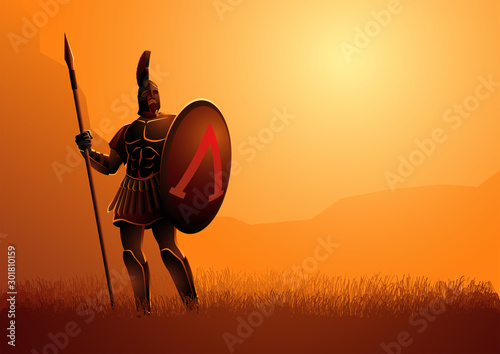 Fototapeta Ancient warrior with his shield and spear standing gallantly on grass field