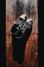 Old Shoes On A Wooden Background