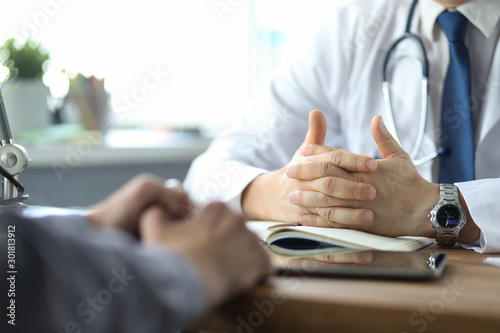 Close-up of doctor and patient hands while doctor listens to patient complaints Fototapete