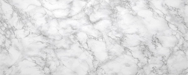 Marble background.White stone texture with gray shadow.Panoramic format.