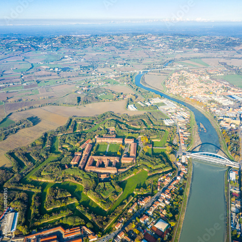 Photo Aerial view of modern six-star hexagon shaped fort Cittadella of Alessandria on winding river Tanaro