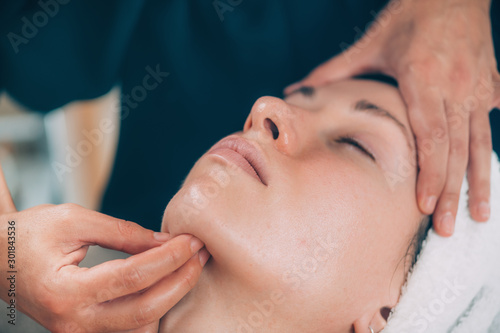 Fotomural  Face Massage with Madero Therapy Wooden Massager