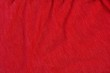 Leinwanddruck Bild - bright red background from a piece of crumpled fabric