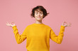 Leinwanddruck Bild - Young brunette woman girl in yellow sweater posing isolated on pastel pink background. People lifestyle concept. Mock up copy space. Hold hands in yoga gesture relaxing meditating keeping eyes closed.