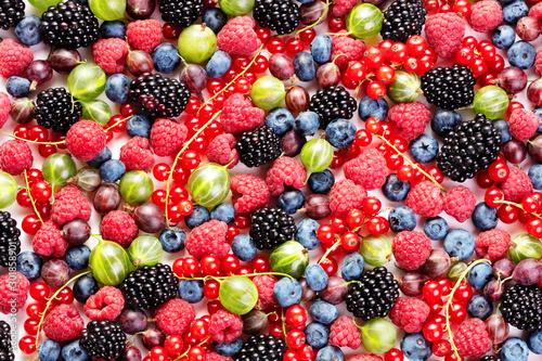 heap of various berry fruits as textured background Wallpaper Mural