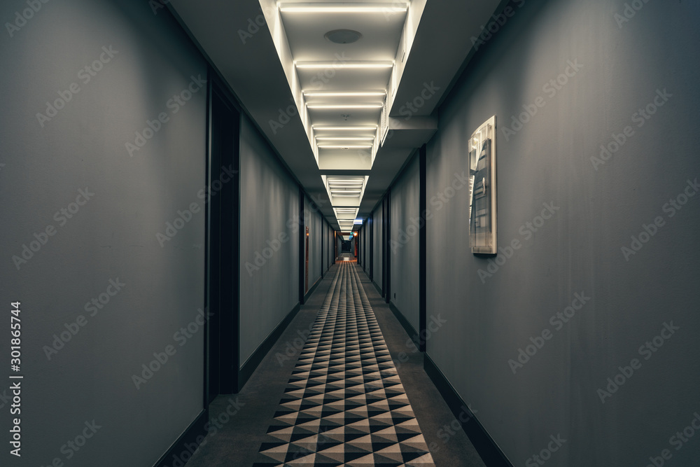 Fototapety, obrazy: Dark corridor with illumination on ceiling. Tunnel view of empty hotel corridor in night time, toned