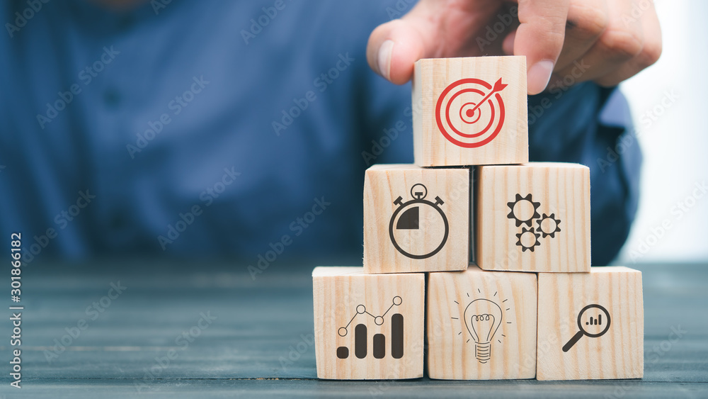 Fototapeta hand stack woods block step on table. business development Decide and choose concept.copy space.