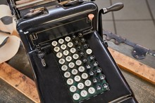 Vintage Calculator And Cash Register On A Counter