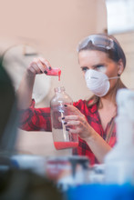 Young Woman Mixing Chemicals I...