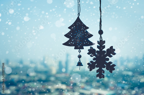Foto auf AluDibond Licht blau christmas ornament ( Snowflake ) hanging mobile on window with blur outdoor landscape background
