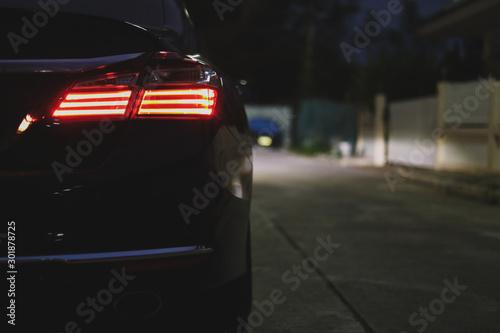 obraz dibond red taillight of modern sport car in the night street