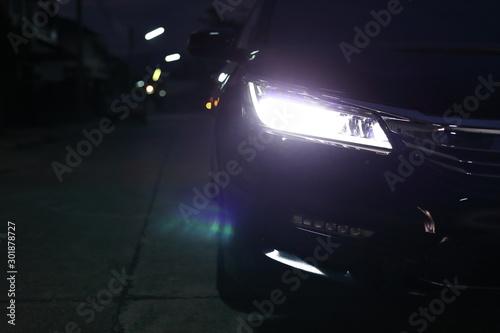 Obraz headlight vehicle car open low light beam in the night urban road - fototapety do salonu