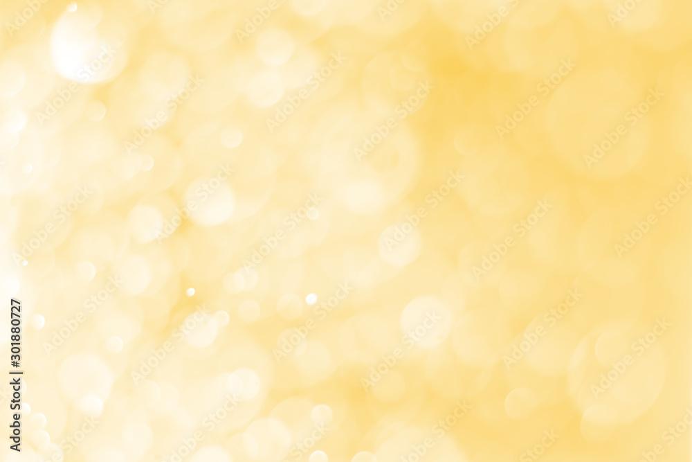 Fototapeta Blurred images of golden bokeh, golden bokeh circles for Christmas, Abstract. - obraz na płótnie