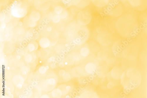 Fototapeta Blurred images of golden bokeh, golden bokeh circles for Christmas, Abstract. obraz na płótnie