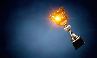 Golden cup on dark . Mixed media