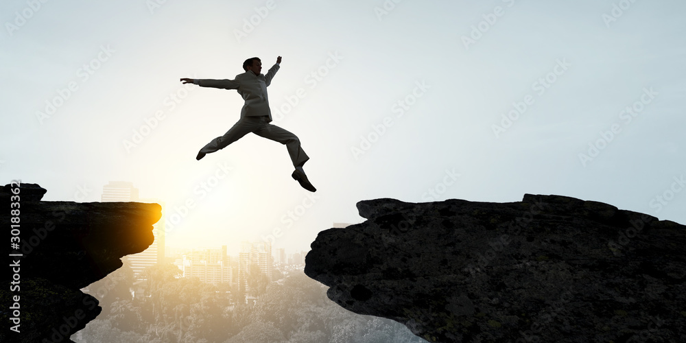 Fototapety, obrazy: Businessman jump over leap. Mixed media
