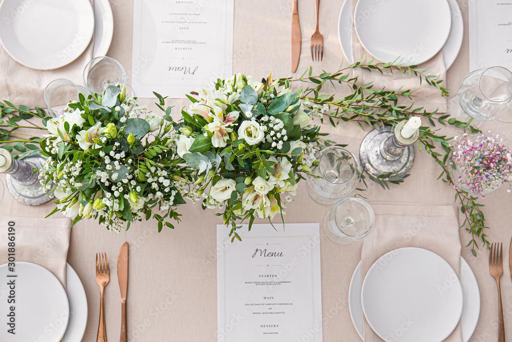 Fototapeta Beautiful table setting for wedding celebration in restaurant
