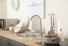 Set Of Clean Dishware Near Kitchen Sink