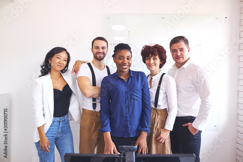 African leader posing in office together with multi-ethnic happy team, employees happy to work with such leader Canvas Print