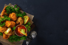 Roasted Vegan Snack Buffalo Wings Made From Broccoli Top View. Tasty Vegetarian Food Top View