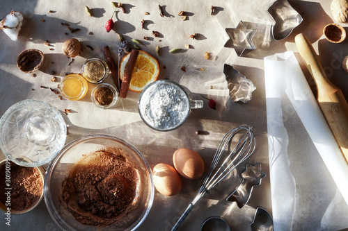 Obraz Christmas bakery, festive food, homemade culinary. Christmas and New year traditional receipts. Ingredients for making gingerbread. - fototapety do salonu