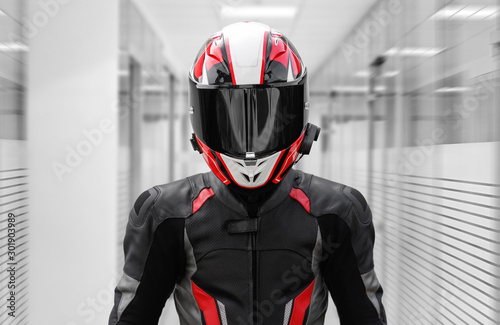 Fotografia A man in a helmet and full motorcycle gear. In offices