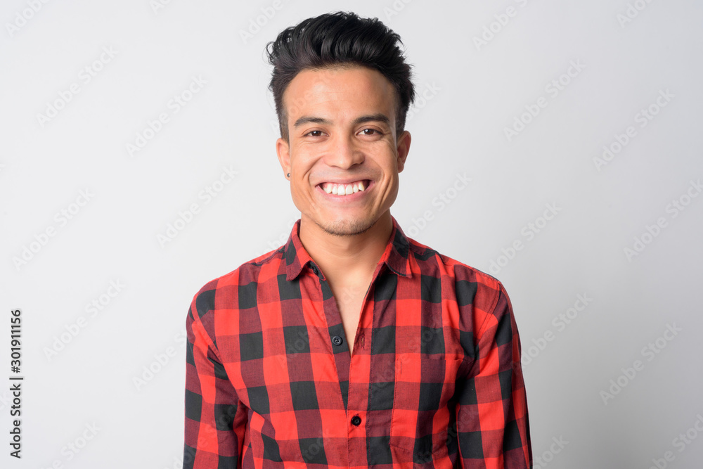 Fototapeta Face of happy young Asian hipster man smiling