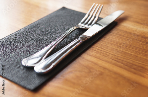 Fotografija  Fork and knife on the table in restaurant