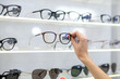 canvas print picture - Close up of the show-window in optical store with glasses