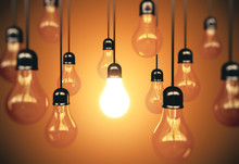 Many Light Bulbs And One Glows