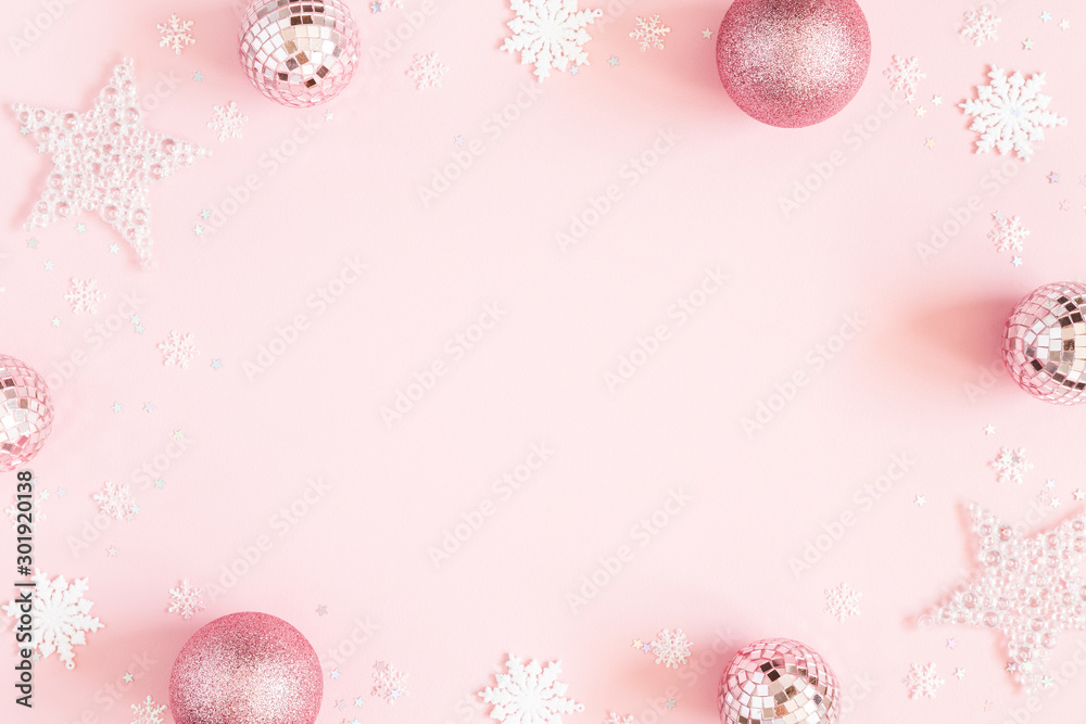 Fototapeta Christmas composition. White decorations on pastel pink background. Christmas, winter, new year concept. Flat lay, top view, copy space