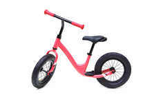 A Red Balance Bike Isolated On...