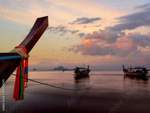 Fotografie, Tablou  Traditional long-tail boat on the beach in Thailand