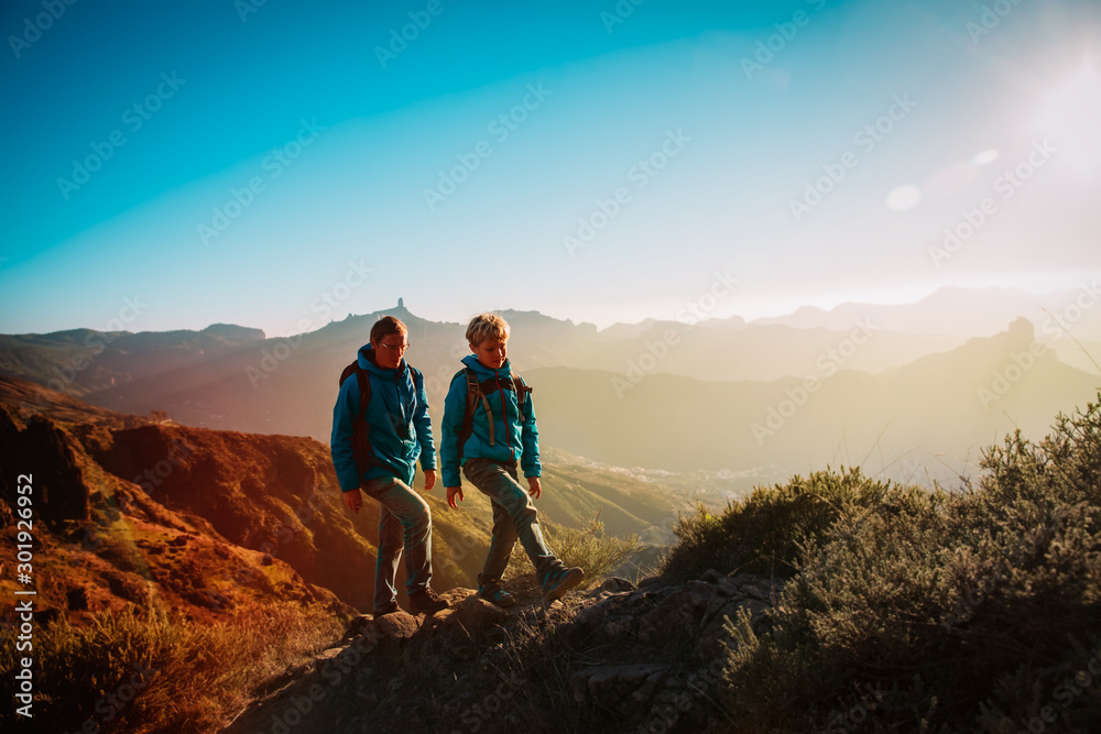 Fototapety, obrazy: father and son hiking in sunset mountains, family travel