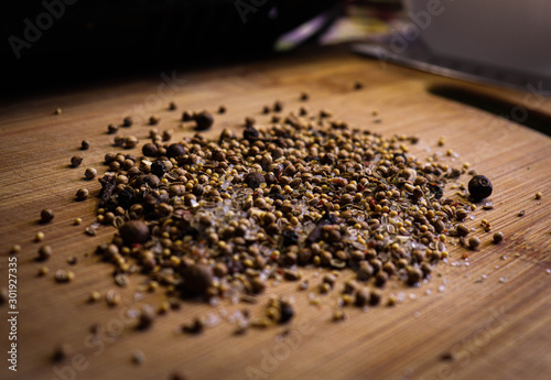 Obraz Closeup spice mix: salt, pepper, mustard, cloves. Can be used for harvesting homemade canned goods. - fototapety do salonu