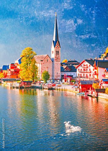 Obraz Austria, Hallstatt historical village. UNESCO world heritage site. Hallstatt is iconic world landmark. Autumn seasonal landscape during sunrise. Two swans on the lake. - fototapety do salonu