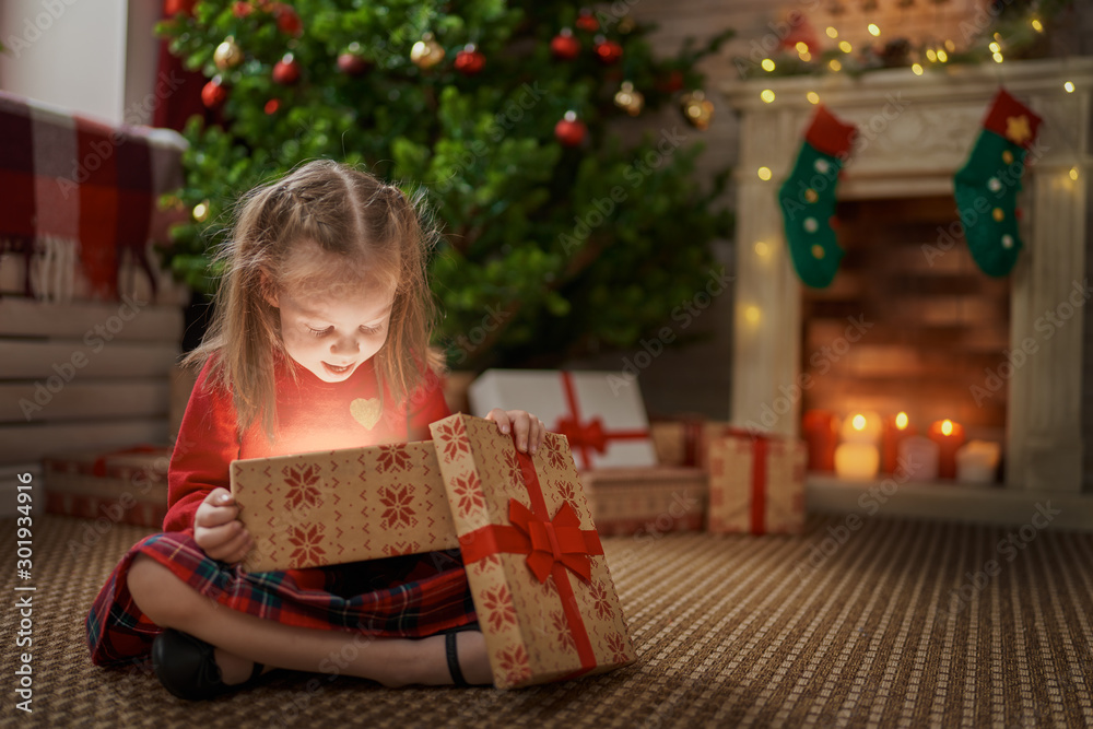 Fototapeta girl with present at Christmas