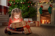 canvas print picture - girl with present at Christmas