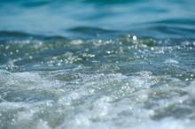 Soft Wave Of Sea On Sandy Beach. Background.