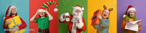 Fotografía  children and Santa Claus on multicolor background.